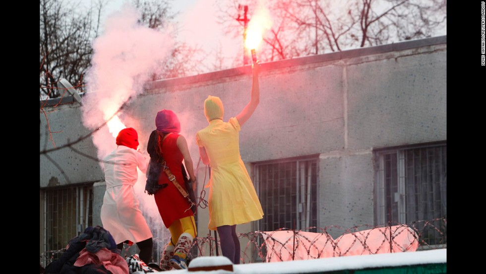 Pussy Riot members stage a performance near a detention center in Moscow to support detained opposition activists Ilya Yashin and Alexei Navalny in December 2011.