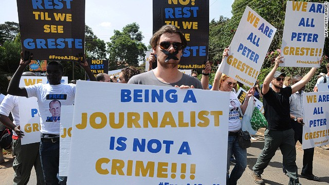 Foreign journalists hold banners as they march to the Egyptian Embassy to show support to Peter Greste, an Australian journalist who was arrested and detained in Cairo while on assignment for Qatar-based Al-Jazeera network, on December 29, 2013, in Nairobi, on February 4, 2014. Greste and two others journalists are accused of spreading lies harmful to state security and joining a terrorist organisation.AFP PHOTO/SIMON MAINASIMON MAINA/AFP/Getty Images
