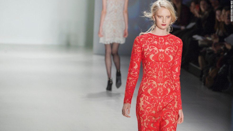 Japanese-born designer Tadashi Shoji sent lace and embroidered gowns down the runway like this red, long-sleeved number on February 6, 2014.