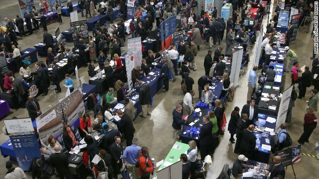 WASHINGTON, DC - JANUARY 10:  People visit booths of prospective employers during the Hiring Our Heroes job fair at the Washington Convention Center, on January 10, 2014 in Washington, DC.  More than 80 companies participate in the job fair that is hosted by the US Chamber of Commerce for U.S. veterans and military spouses.  (Photo by Mark Wilson/Getty Images)