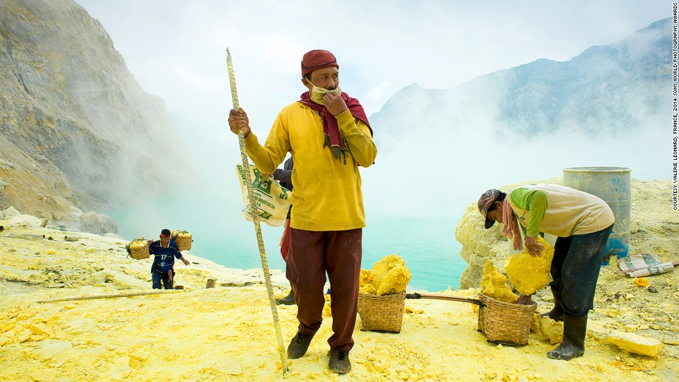 "<strong>Shortlist: The Messiah</strong><br />Photo and caption by Valerie Leonard<br />""In East Java, Indonesia lies Kawah Ijen volcano, 11,500 feet tall, topped with a large caldera and a 650-feet-deep lake of sulfuric acid. The quietly active volcano emits gases through fumaroles inside the crater, and local miners have tapped those gases to earn a living. The first miners arrived here 50 years ago. Stone and ceramic pipes cap the fumaroles, and inside, the sulfur condenses into a molten red liquid, dripping down."""