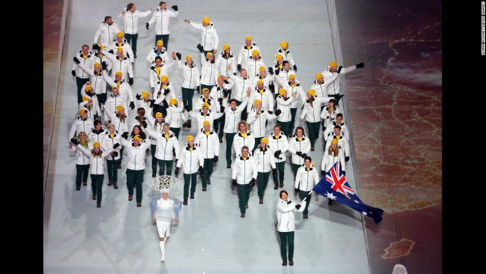 Snowboarder Alex Pullin of the Australian Olympic team carries his country's flag during the opening ceremony.
