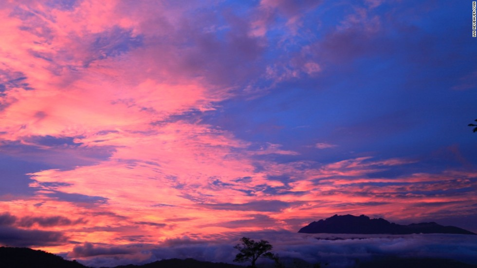 Sunrise colors change throughout the morning. These steaks overlook the Crocker Range, a mountainous spine with an average height of 1,800 meters that divides the west and east coasts of Sabah.