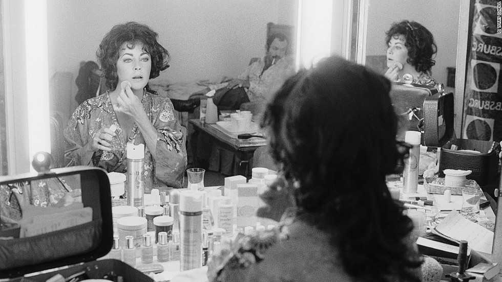 "O'Neill took this photo inside Elizabeth Taylor's dressing room as she shot the film ""A Little Night Music"" in the late 70s. ""She was going to announce her engagement to John Warner later that day,"" he remembers. Despite her big screen presence O'Neill says Taylor was more of a delight than a diva: ""She was really quite shy at being a star."" You can see O'Neill in the mirror."