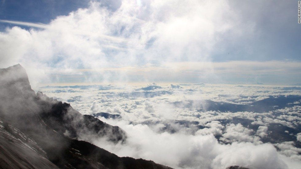 By 9 a.m., clouds begin to ascend over the summit plateau. Rain follows shortly after.