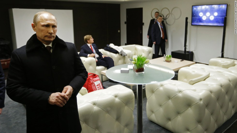 Putin waits to be introduced at the ceremony.