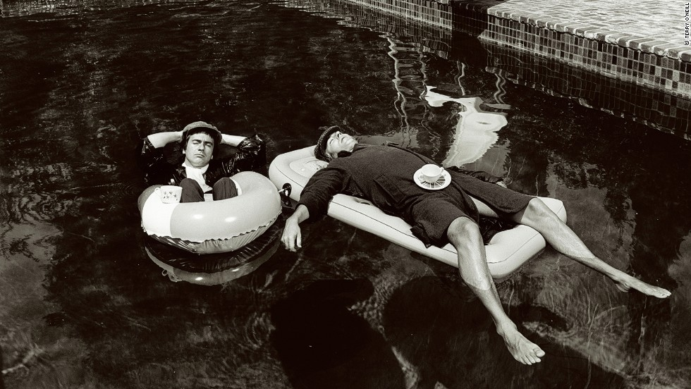 British actor-comedians Dudley Moore and Peter Cook were inseparable. In 1975 O'Neill photographed the pair wearing raincoats and floating in a swimming pool at the house of Keith Moon, the lead drummer for The Who.