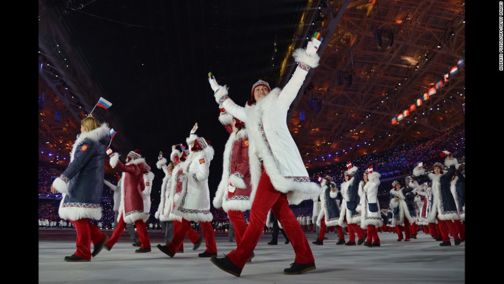 Russia's delegation parades through the stadium.