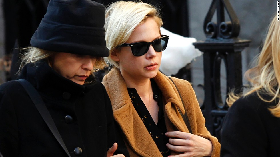 "Actress Michelle Williams, wearing glasses, worked with Hoffman in ""Synecdoche, New York."""
