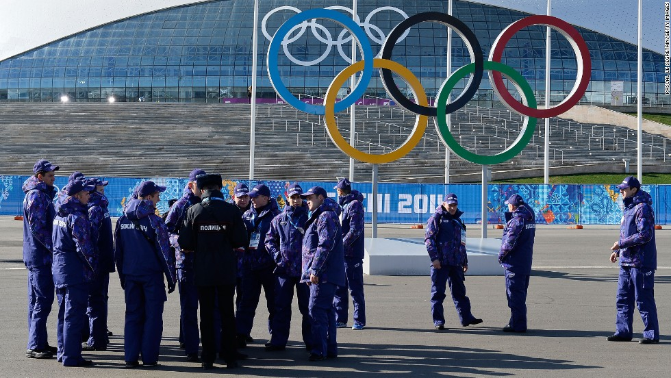 A security team gathers near Olympic rings in Sochi on February 4.