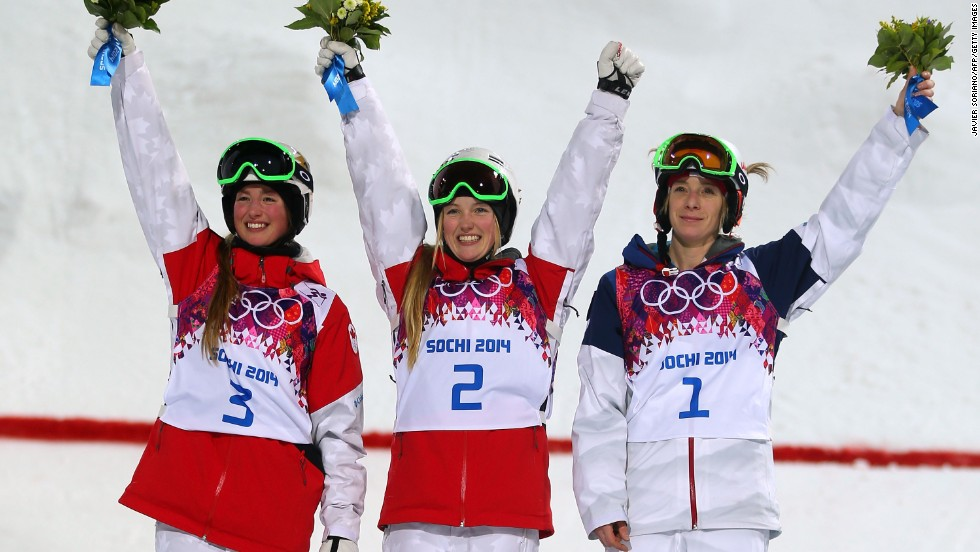(From left to right) Silver medalist Chloe Dufour-Lapointe of Canada, gold medalist Justine Dufour-Lapointe of Canada and bronze medalist Hannah Kearney of the U.S. give a wave following the conclusion of the women's moguls event.
