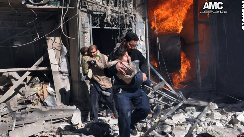 In this photo provided by the anti-government activist group Aleppo Media Center, Syrian men help survivors out of a building in Aleppo after it was bombed, allegedly by a Syrian regime warplane on Saturday, February 8.