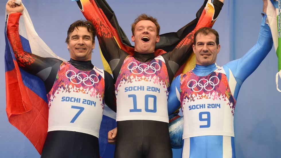 Germany's gold medal winner in the luge Felix Loch is flanked by Russia's silver medalist Albert Demchenko and Italy's Armin Zoeggeler, who took bronze.