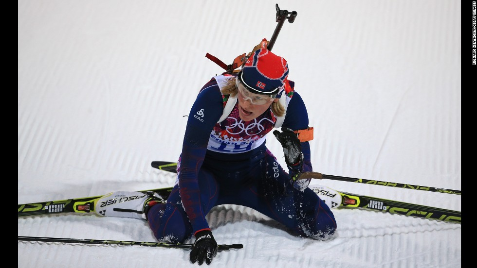 Biathlete Tora Berger of Norway collapses at the end of the women's 7.5-kilometer sprint.