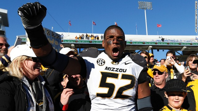 LEXINGTON, KY - NOVEMBER 9: Michael Sam #52 of the Missouri Tigers celebrates with fans after the game against the Kentucky Wildcats at Commonwealth Stadium on November 9, 2013 in Lexington, Kentucky. Missouri won 48-17. (Photo by Joe Robbins/Getty Images)
