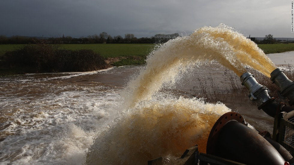 Floodwater is pumped into the River Parrett near Fordgate, England, on February 9.