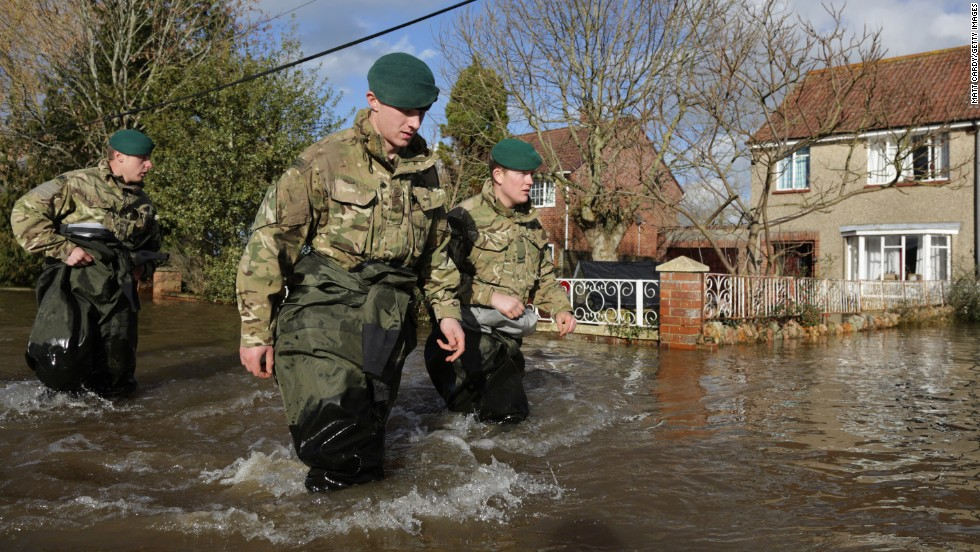 Royal Marines wade past flooded properties in Bridgwater, England, on February 7.
