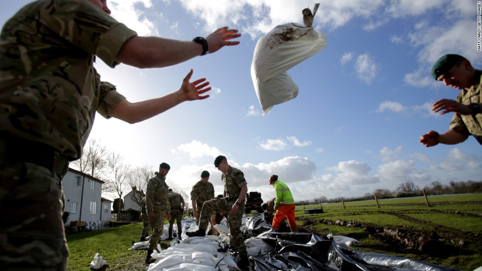 Royal Marines build a sandbag wall around a property near Bridgwater on February 7.