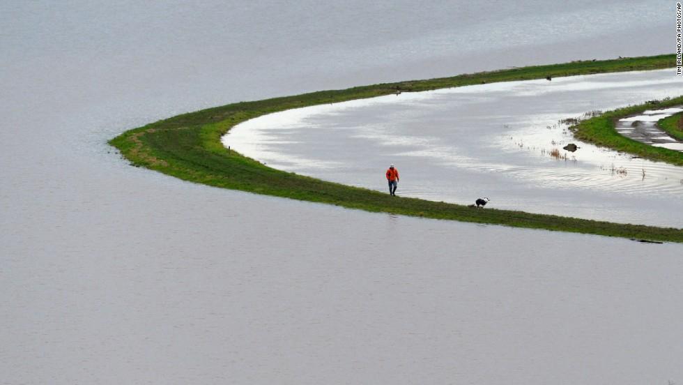 A man walks beside the River Tone near Burrowbridge, England, on Wednesday, January 29.