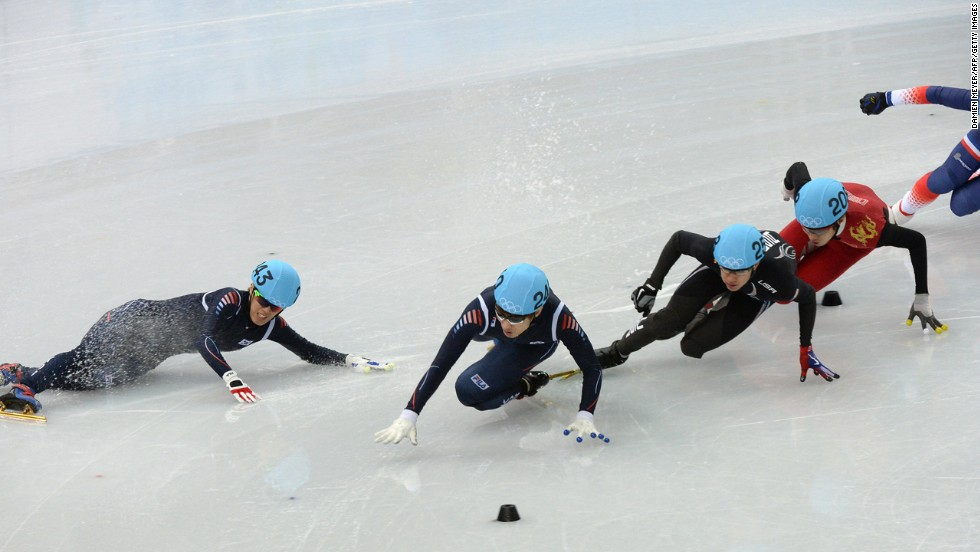 South Korea's Sin Da-Woon, left, falls as he competes in the 1,500-meter short track semifinals on February 10.