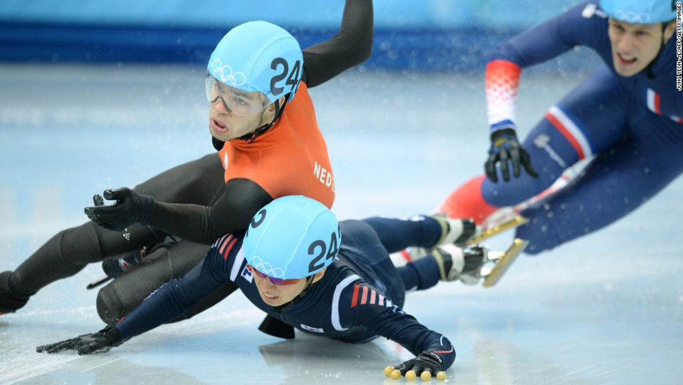 Dutch speedskater Sjinkie Knegt, left clashes with South Korea's Park Se Yeong in the men's 1,500-meter short track race.