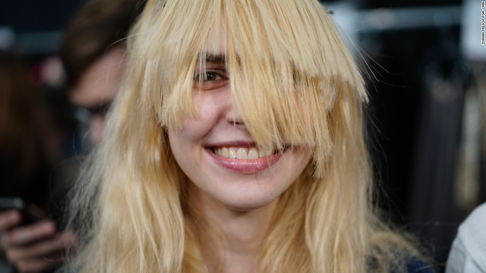 A model gets hair extensions added for the Custo Barcelona show on February 9.