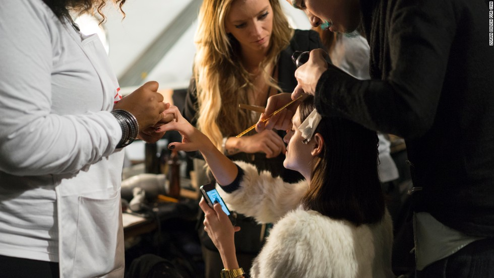 No detail is left untouched as a model gets her hair, makeup and nails simultaneously done for Mathieu Mirano's show.