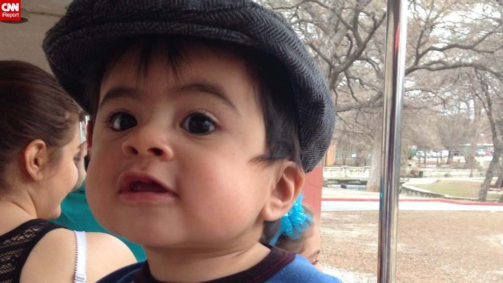 """""""I don't know what's happening, but it's exciting!"""" -- Jaxson Soto, 13 months, was pretty pumped about his first train ride through Brackenridge Park in San Antonio, Texas."""