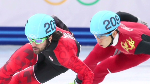 Canadian speed skater Hamelin takes gold