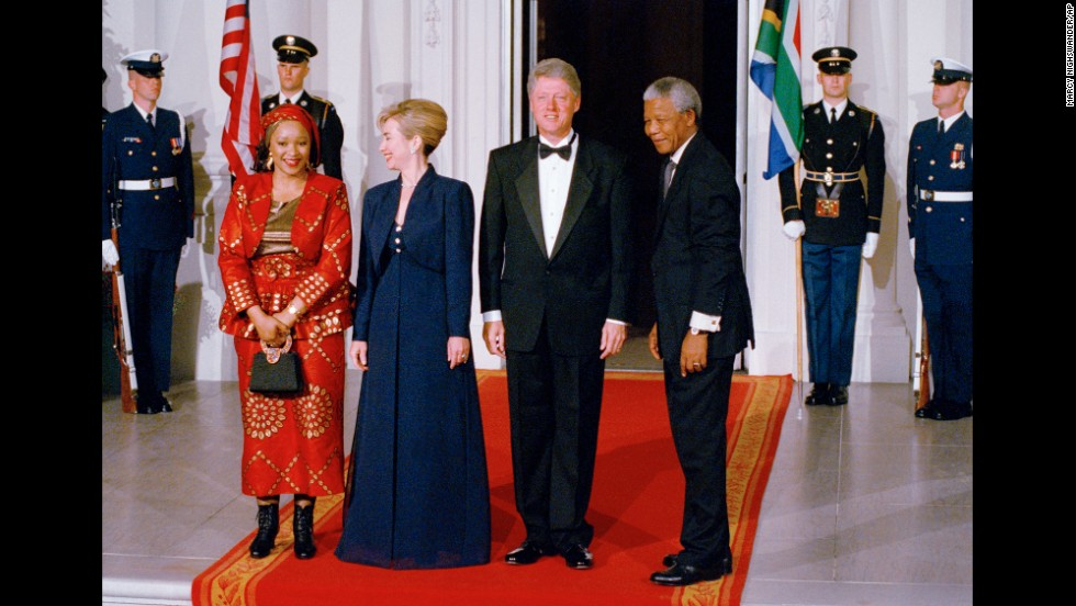 President Bill Clinton and first lady Hillary Clinton stand with South African President Nelson Mandela and his daughter, Zinzi Mandela Hlongwane, at a state dinner on October 4, 1994.