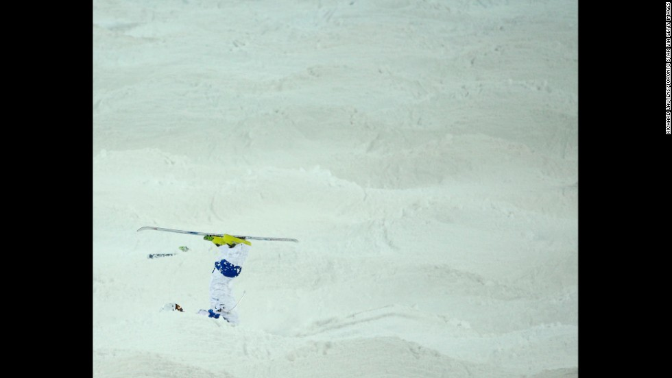 Russia's Sergey Volkov tumbles during the men's moguls.