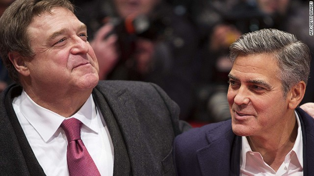 US actors John Goodman (L) and George Clooney (R) arrive on the red carpet for the screening of the film The Monuments Men presented in the Berlinale Competition of the 64th Berlinale Film Festival in Berlin, on February 8, 2014. The 64th Berlinale, Europe's first major film festival of the year, starts with 23 international productions screening in the main showcase. AFP PHOTO / DAVID GANNONDAVID GANNON/AFP/Getty Images