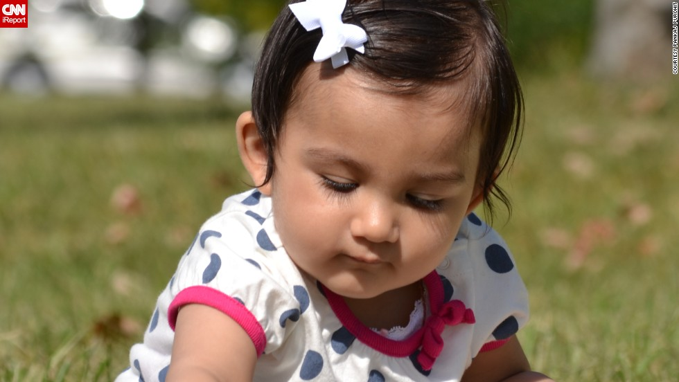 """""""Hey Mom ... I am picking some fresh greens for salad today"""" -- Rhea Purohit, age 9 months, forages in New Jersey's Liberty State Park."""