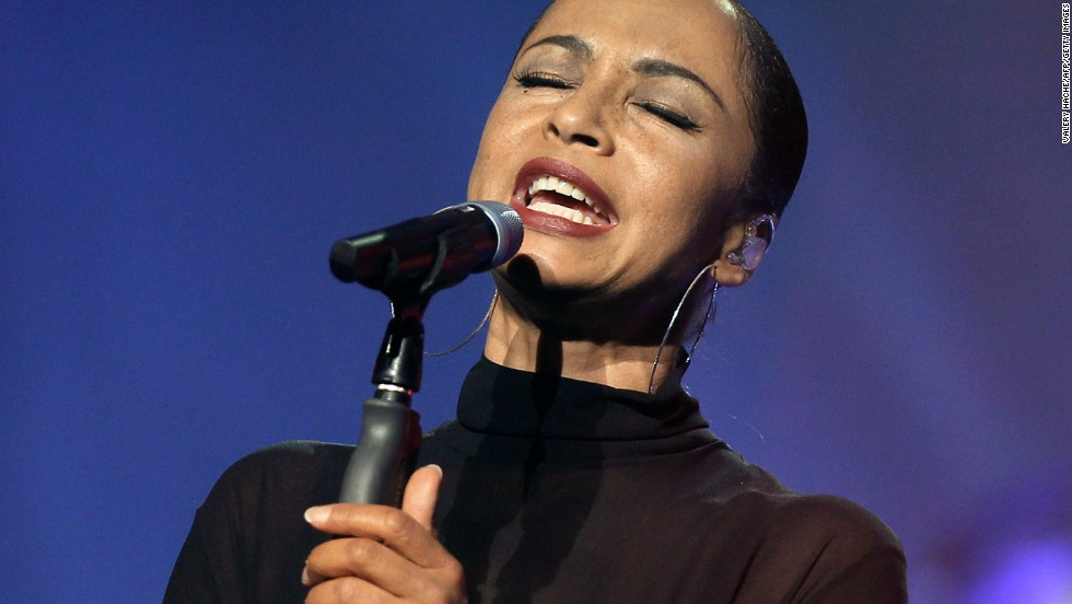 "Nigerian-British singer Sade was<a href=""http://www.washingtonpost.com/blogs/click-track/post/letting-down-her-guard-only-sade-knows-how-long-shell-stand-in-the-spotlight/2011/06/22/AGIm5cfH_blog.html"" target=""_blank""> raised in Holland-on-Sea</a> by her mother."