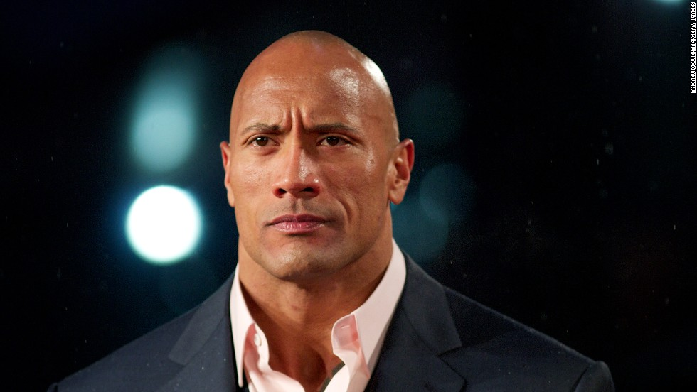 "Dwayne ""The Rock"" Johnson described himself as ""half-black and half-Samoan"" to Vibe magazine in 1999. He is the son of wrestler Rocky Johnson and grandson to wrestler Peter Maivia, who was Samoan."