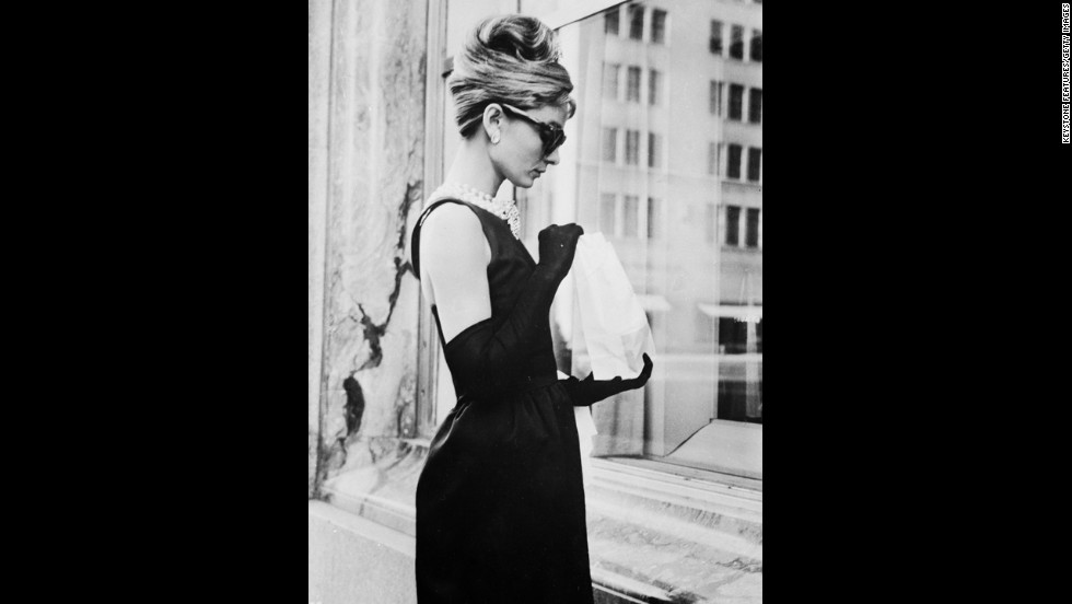"Actress Audrey Hepburn embodies ladylike fashion in a stunning black dress in ""Breakfast At Tiffany's."" Hepburn was close friends with Hubert de Givenchy, who made many of the dresses she wore in films and in her own life."