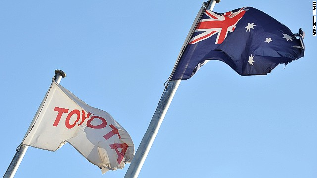 A damaged Australian flag (R) flies next to the Toyota flag at their Toyota Motor Corporation Altona manufacturing plant in Melbourne on February 10, 2014. Toyota on February 10 said it will stop making cars in Australia in less than four years, banging the final nail in the coffin of country's auto industry, despite appeals to stay by Prime Minister Tony Abbott. AFP PHOTO / Paul CROCKPAUL CROCK/AFP/Getty Images