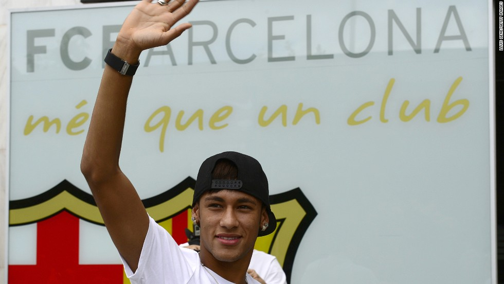 Neymar waves to the crowds after signing a five-deal with Barcelona, but the full nature of the transfer is now under investigation.