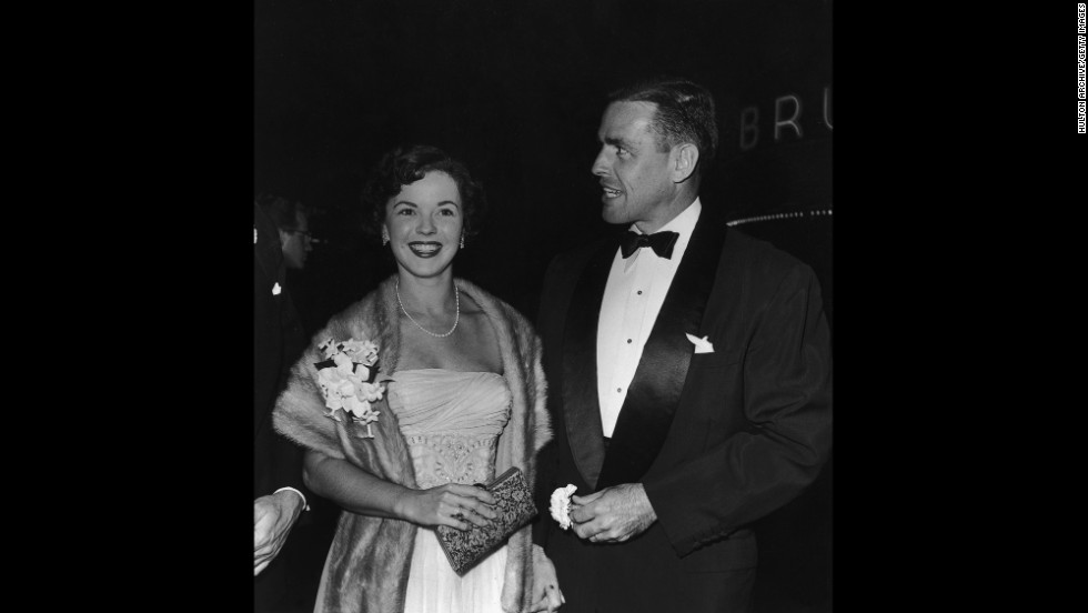 "Temple and her second husband, Charles Black, arrive at the premiere of ""Roman Holiday"" in 1953."