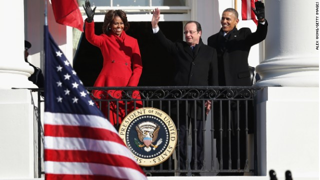 President Barack Obama, first lady Michelle Obama, and French President François Hollande wave from the balcony of the White House during an arrival ceremony in Washington, DC. President Hollande is on a three-day state visit to the U.S.  (Photo by Alex Wong/Getty Images)