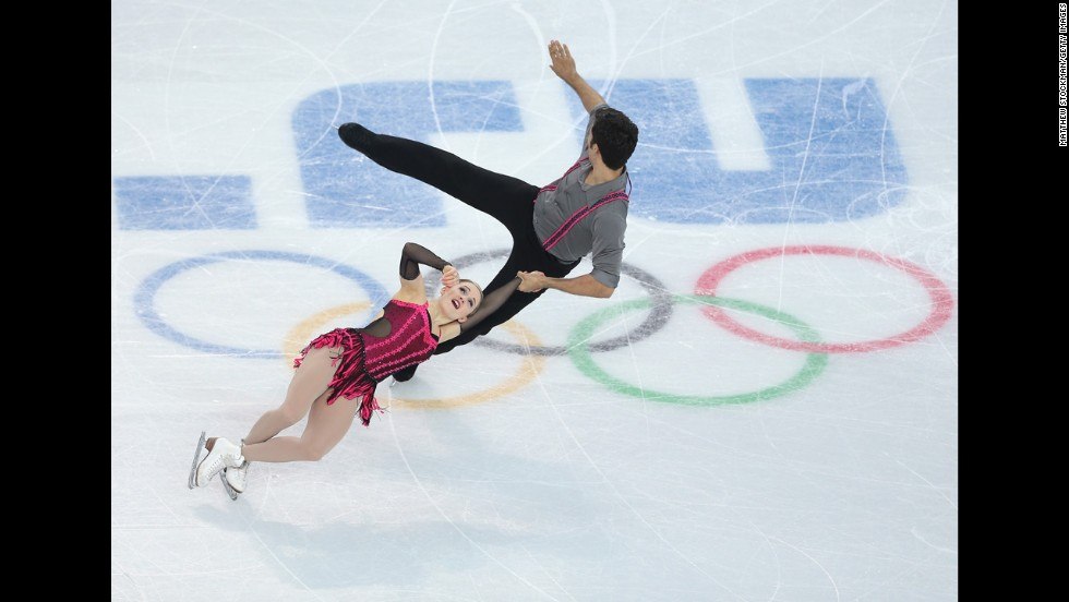 Paige Lawrence and Rudi Swiegers of Canada compete in pairs figure skating on February 11.