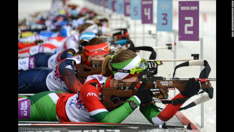 Belarussian biathlete Darya Domracheva, foreground, shoots during the women's 10-kilometer pursuit on February 11.