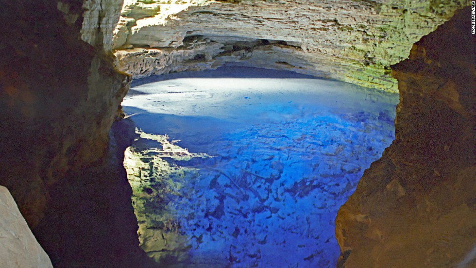The Poço Encantado (Enchanted Well) in Brazil is an underground lake with a window to the Bahian jungle above.
