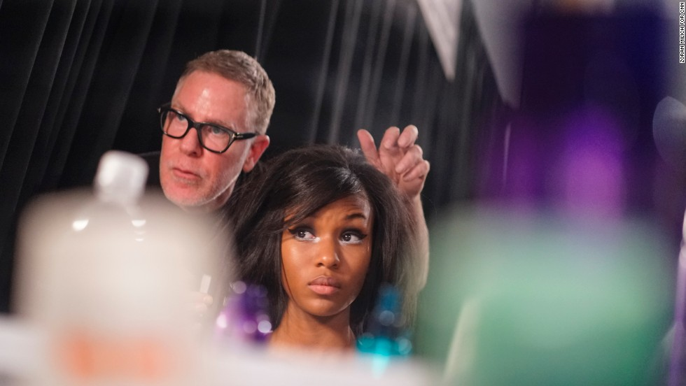 A hairdresser touches up a model's mod bob before the Libertine show on February 11.