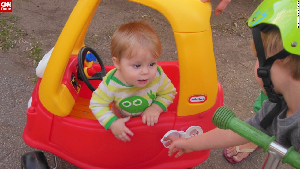 """""""I'm out of gas!  Can someone give me a push?"""" -- Owen Flemming Banks, age 11 months, hopes to get a push from 4-year-old brother, Mason."""