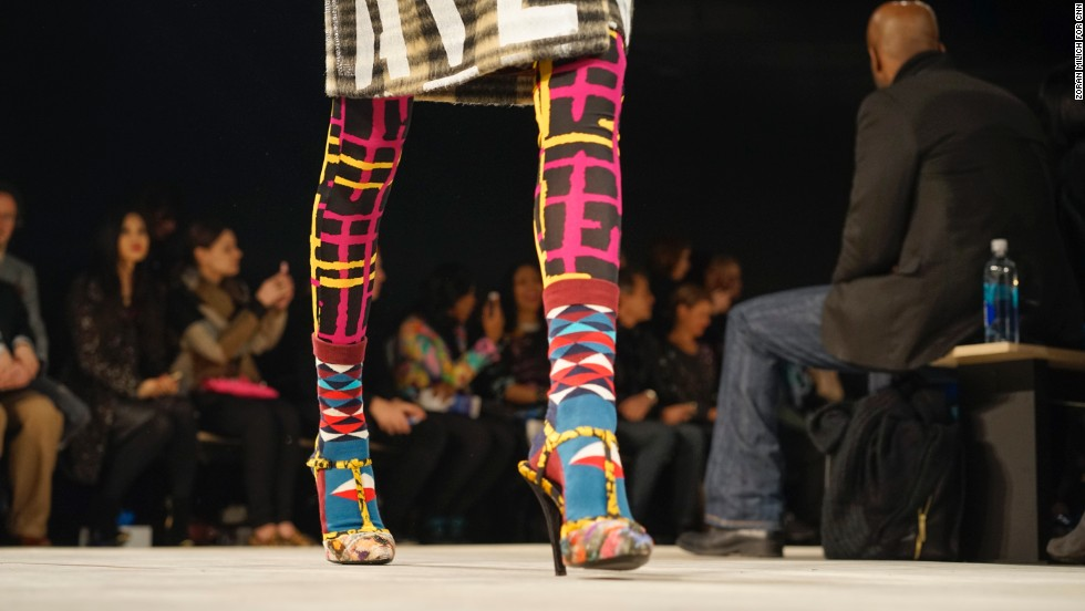 Socks were layered on top of tights for an extra layer of warmth -- and color! T-strap heels appeared in Libertine's show, and have been seen throughout many of the fall collections.