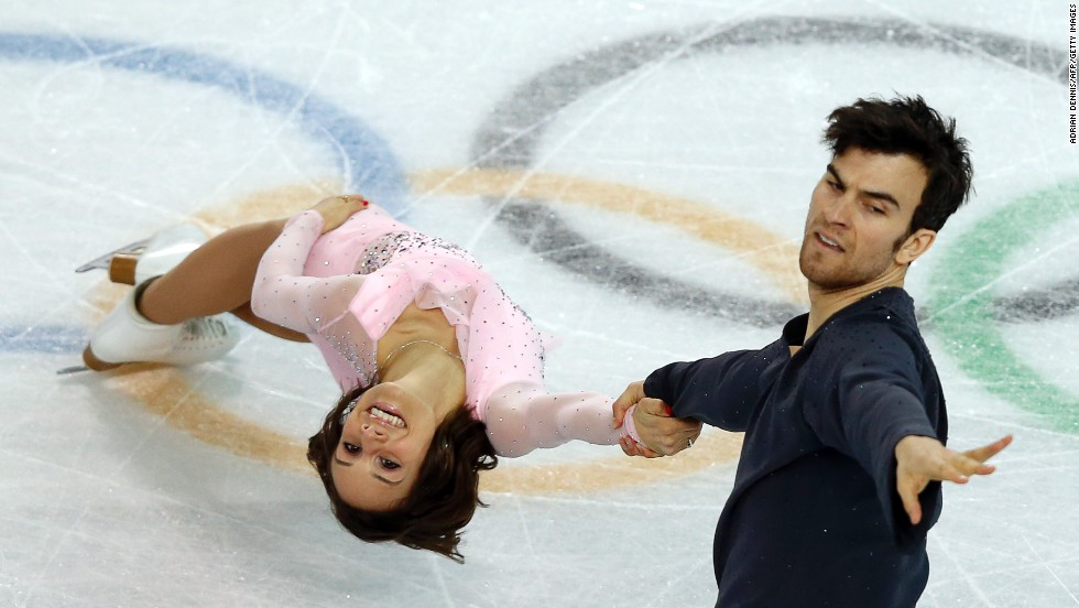 Canada's Meagan Duhamel and Eric Radford perform their short program in the pairs figure skating event.