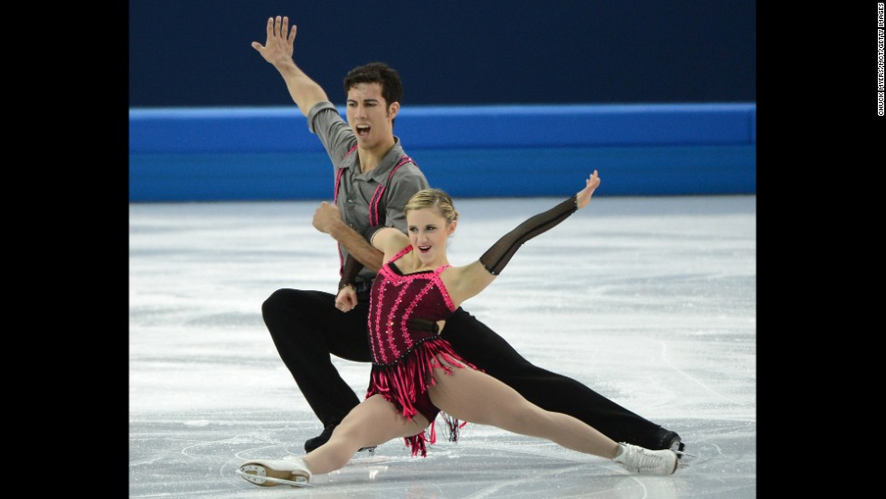 Canadian figure skaters Paige Lawrence and Rudi Swiegers continue their routine.