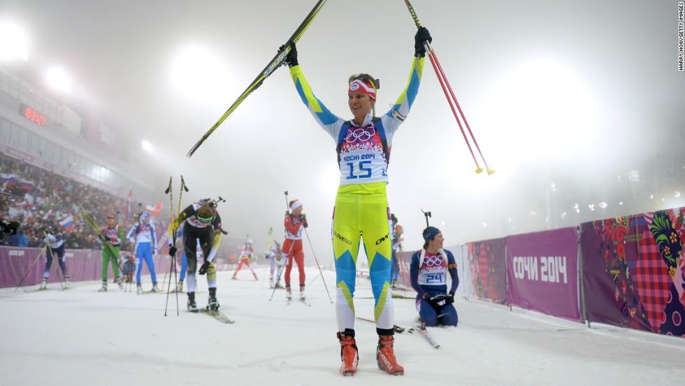 Biathlete Teja Gregorin of Slovenia celebrates after finishing the women's 10-kilometer pursuit on February 11.