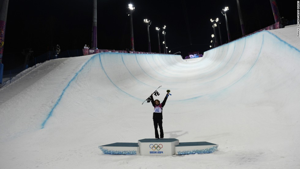Halfpipe gold medalist Iouri Podladtchikov celebrates on the podium after the flower ceremony on February 11.